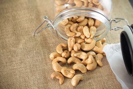 cashew: Roasted cashew nuts on wooden background soft focus Stock Photo