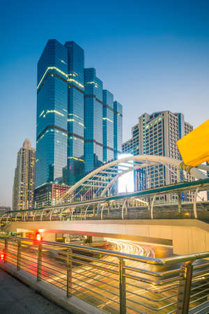 distric: Public skywalk with office building - Marchl 15 2015 :  Public skywalk with Building architecture style modern ,business area in city of Bangkok, Thailand Editorial