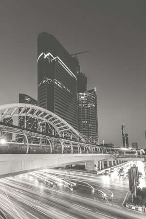 distric: Public skywalk with office building - Marchl 15 2015 :  Public skywalk with Building architecture style modern ,business area in city of Bangkok, ThailandImage processed by black and white theme