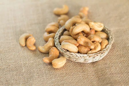 nuts: Roasted cashew nuts on wooden background soft focus Stock Photo