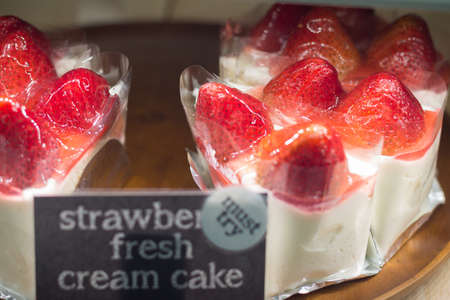 soft sell: Slice of sweet strawberry cake for sell soft focus