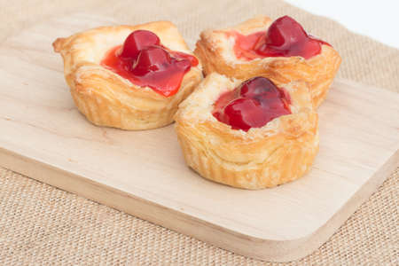 wood block: Fresh fruit pie tart with cherry that serve on wood block capture with natural light