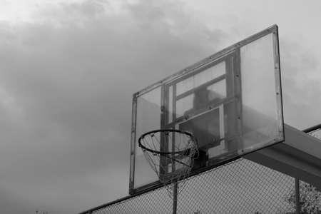 Basketball backboard and the stormy sky backgroundblack and white theme Reklamní fotografie