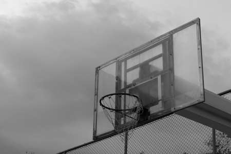 backboard: Basketball backboard and the stormy sky backgroundblack and white theme Stock Photo