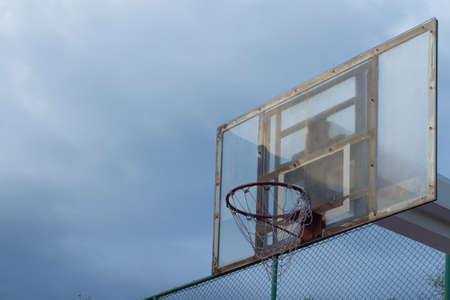 Basketball backboard and the stormy sky