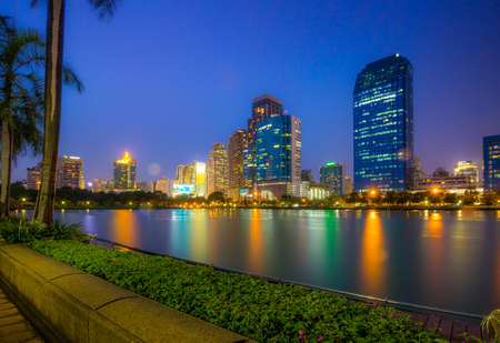 benjakitti: Bangkok, Thailand - Marchl 21 2015 : Landscape of Bangkok city in night time. Capture from Benjakitti Park in Bangkok. This place is very popular that tourists like to take photos of modern architecture. Editorial