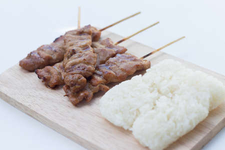 meat alternatives: Grilled pork in asian style sticky rice that in Thailand is famous food for breakfast.selective focus