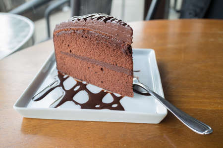 shiver: Piece of chocolate cake with warm chocolate syrupsoft focus