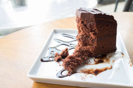 shiver: Piece of chocolate cake with warm chocolate syrup(soft focus) Stock Photo