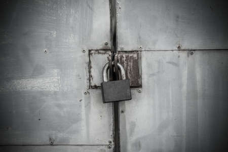 Old iron lock on the metal door (horror theme) Stock Photo