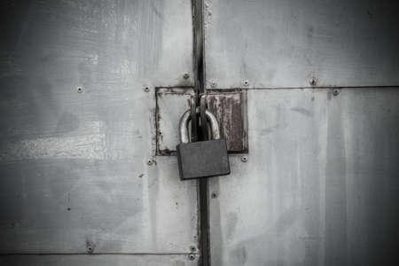 circumspect: Old iron lock on the metal door (horror theme) Stock Photo