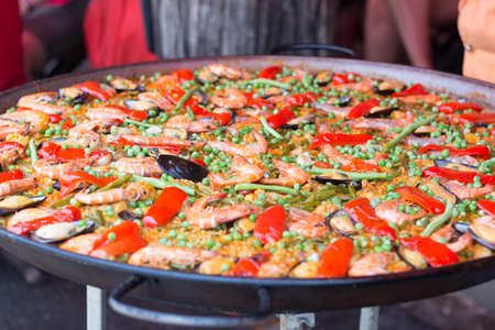 Traditional spanish rice paella with sea food. Mixed seafood stir fried spicy and salad.