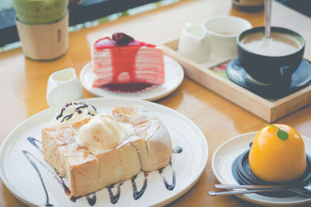 Honey toast with strawberry cake and hot coffee. Honey toast in cozy outdoor cafe.(selective focus, vintage effect)