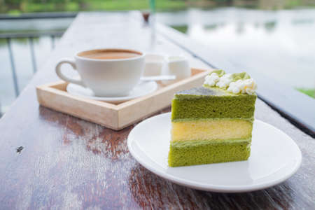 green tea cake with coffee breakfast set in outdoor restaurant Stock Photo