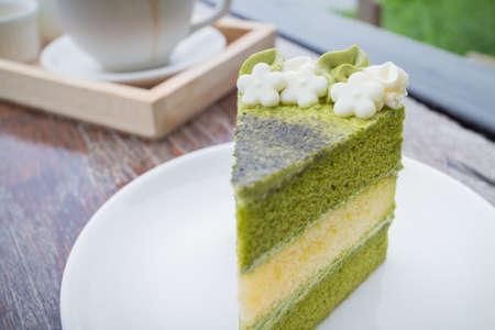green tea cake with coffee breakfast set in outdoor restaurant Stock Photo