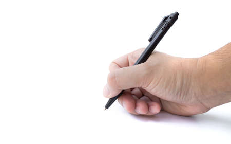 Hand writing on copy space. Male hand holding black pen isolated on white background