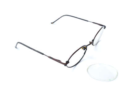 Old glasses with broken brown lens and frame isolated on white..