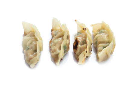 Picture of fried dumplings or gyoza isolated on white background