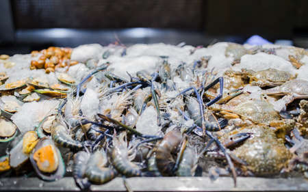 Picture of fresh green mussel, prawns and crab in seafood on ice buffet bar