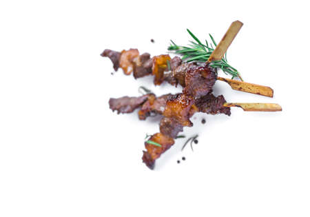 Grilled beef meat with rosemary and pepper isolated on white background