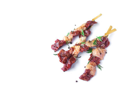fresh raw beef meat with rosemary and pepper isolated on white. Food meat preparation cooking concept