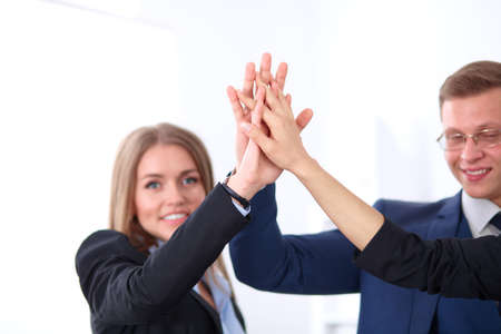 joining hands: Business people group joining hands and representing concept of friendship and teamwork