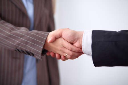 coalition: Business people shaking hands, standing Stock Photo