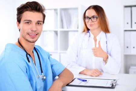 attractive male: Attractive male doctor near female doctor