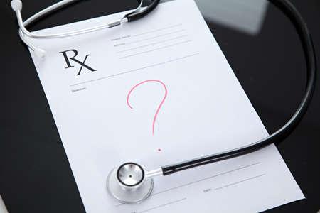 reflective: Stethoscope and prescription, black reflective background Stock Photo