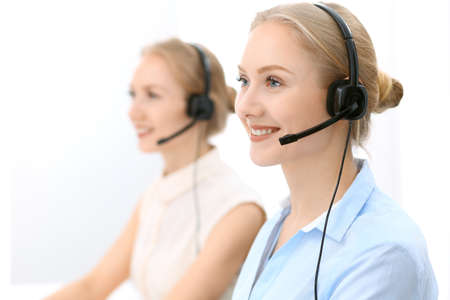 Call center. Focus on beautiful blonde woman in headset Stock Photo