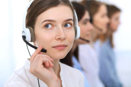 customer support: Call center operator.Young beautiful business woman in headset.