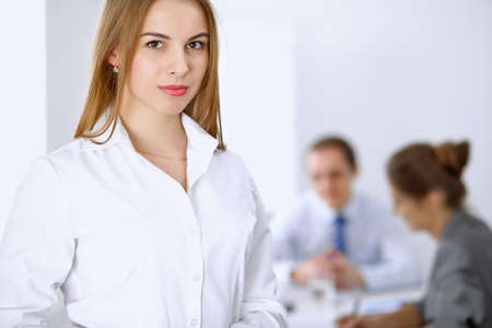 Beautiful business woman on the background of business people