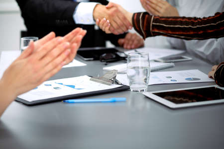unanimous: Business people shaking hands, finishing up a meeting. Stock Photo