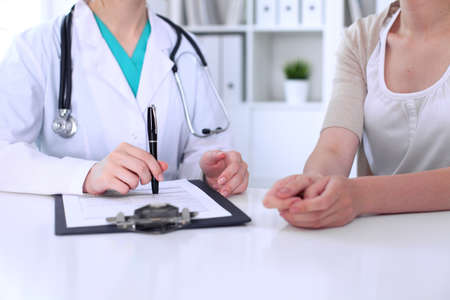 complaints: Doctor and patient are discussing something, just hands at the table