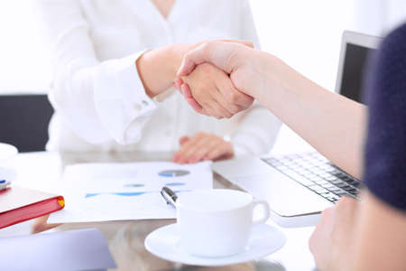 unanimous: Business handshake. Two women are shaking hands after meeting or  negotiation.