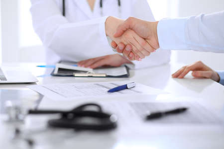 Doctor and patient handshaking. Hands close-up concept. Stock Photo