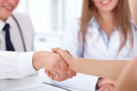 handclasp: Partnership, trust and medical ethics concept in health care