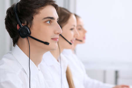 toothy: Call center. Focus on a man in headset