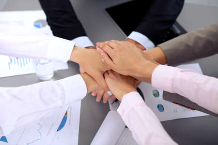 joining: Business people group joining hands and representing concept of friendship and teamwork