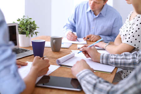 cup four: Hands of business people meeting around table. Start up team Stock Photo
