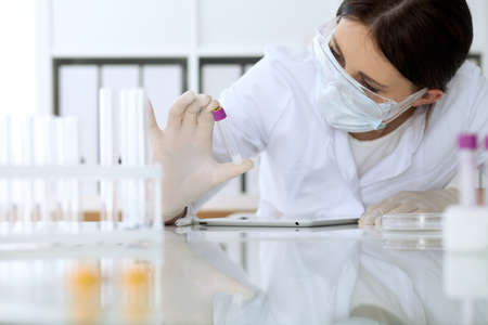 Close up of scientific research hands with clear solution in laboratory