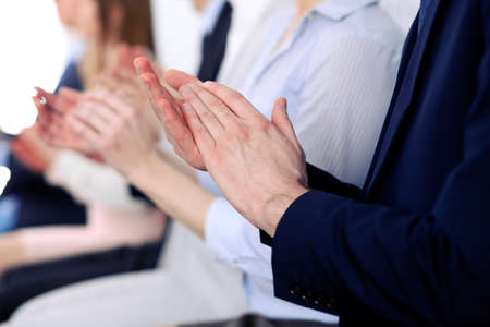 ovation: Close up of business people hands  clapping at conference