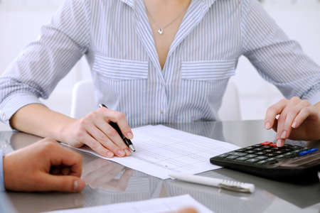 Bookkeepers or financial inspector making report, calculating or checking balance. Audit concept Stock Photo