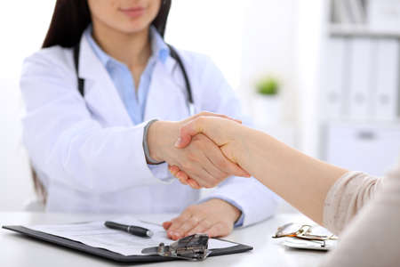 handclasp: Partnership, trust and medical ethics concept