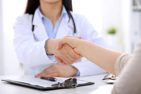 handclasp: Partnership, trust and medical ethics concept. Medicine and health care concept Stock Photo
