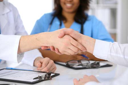 african american handshake: Doctor and patient handshake. Medicine and health care Stock Photo