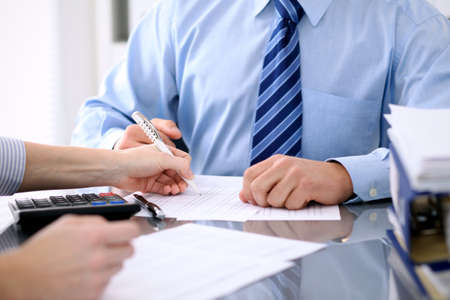 Bookkeepers or financial inspector making report, calculating or checking balance. Audit concept 스톡 콘텐츠