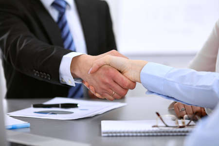 Business people shaking hands, finishing up a meeting Stock Photo