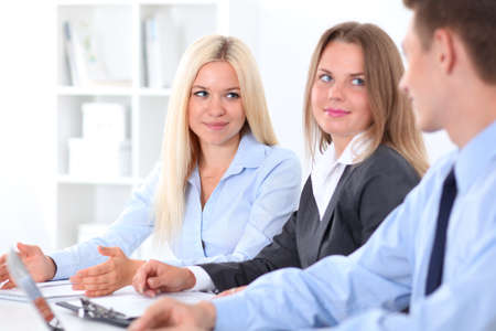 Business people discussing the ideas at meeting , focus on blond woman
