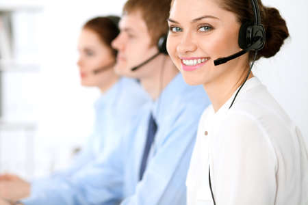 Call center operators. Focus at  business woman in headset